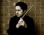 Adam Kornas, conductor